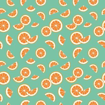 Seamless brillante primavera ed estate pattern con arance mandarini e fette su verde