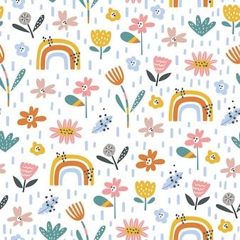 Motivo infantile senza soluzione di continuità con fiori e arcobaleni in stile cartone animato perfetto per il tessuto della carta da parati