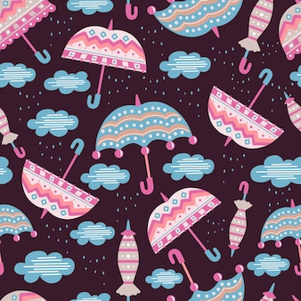 Modello per bambini senza soluzione di continuità con ombrelloni e nuvole. stile doodle. gli oggetti sono isolati.