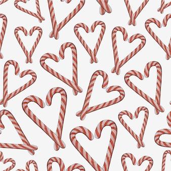 Seamless pattern di natale di bastoncini di zucchero a forma di cuore.nuovo anno e natale.acquerello