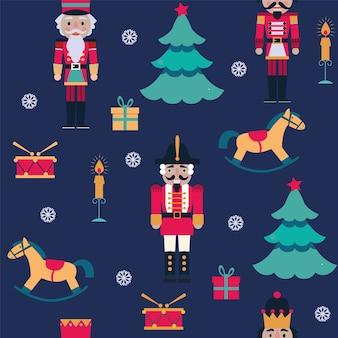 Seamless pattern di natale con schiaccianoci, fiocchi di neve, giocattoli, albero su sfondo blu.
