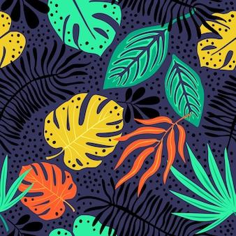 Modello esotico senza cuciture con piante tropicali