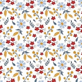 Motivo floreale senza soluzione di continuità, mix di fiori grandi e piccoli ed elementi botanici.