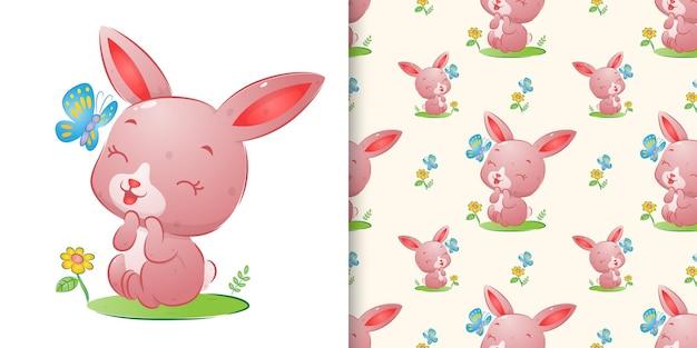 La mano senza giunte disegnata del simpatico coniglio che sorride alla farfalla colorata dell'illustrazione