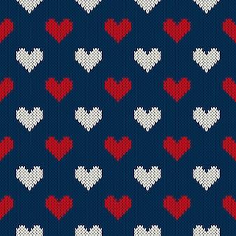 Modello a maglia senza cuciture con i cuori. san valentino sfondo