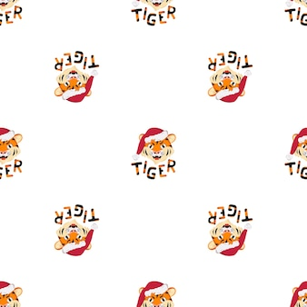 Patern senza cuciture con tigre felice, simbolo del nuovo anno in cappello di babbo natale rosso. stampa per decorazioni natalizie con scritte a strisce arancioni