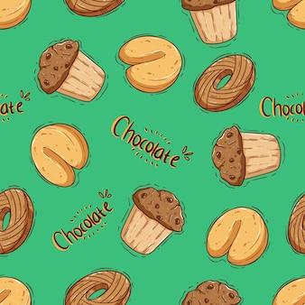 Modello senza cuciture di biscotti e cupcake con stile di disegno a mano