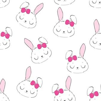 Coniglietto sveglio senza cuciture e fiocco rosa su sfondo bianco
