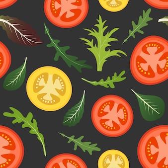 Modello senza cuciture su oscurità con pomodori rossi e gialli.