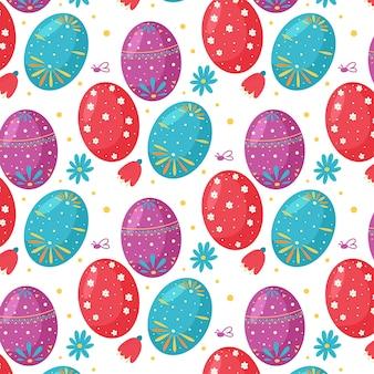 Modello senza cuciture delle uova di pasqua e dei fiori. perfetto per carta da parati, carta regalo, riempimenti a motivo, sfondo della pagina web, biglietti di auguri primaverili e pasquali