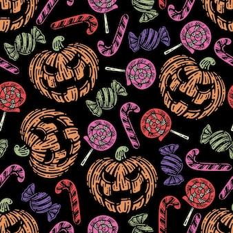 Modello senza cuciture di halloween con elementi di caramelle su sfondo scuro