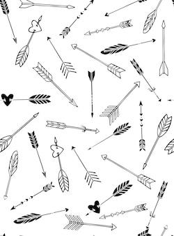 Modello senza cuciture delle frecce disegnate a mano in stile boho