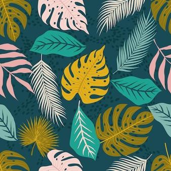 Modello senza cuciture dello sfondo della natura con foglie tropicali