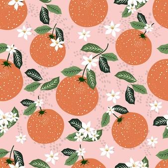 Modello senza cuciture di frutti di arance con foglie tropicali e bellissimi fiori