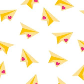 Modello senza cuciture di aeroplano di carta origami e cuore