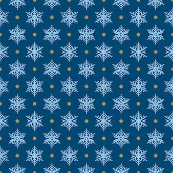 Modello senza cuciture di fiocchi di neve e punti, azzurro su blu
