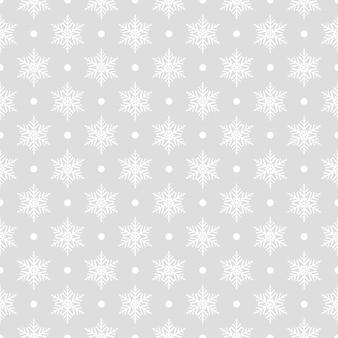 Modello senza cuciture di fiocchi di neve e punti, bianco su grigio