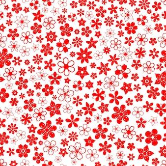 Modello senza cuciture di vari piccoli fiori nei colori rossi