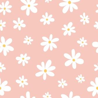 Modello senza cuciture di camomille bianche su sfondo rosa in uno stile piatto