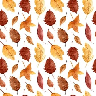 Modello senza cuciture con foglie autunnali dorate e marroni