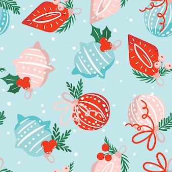 Modello senza cuciture con ornamenti natalizi disegnati a mano decorati con foglie sacre e rami di pino nei colori rosso, blu, bianco