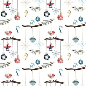 Modello senza cuciture con ornamenti natalizi, fiocchi di neve, caramelle e alberi