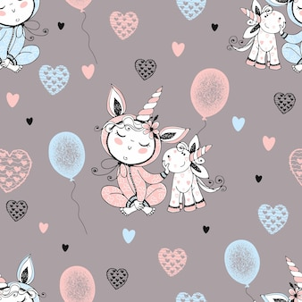 Modello senza cuciture con un bambino carino in pigiama con il suo unicorno giocattolo e palloncini. vettore. Vettore Premium