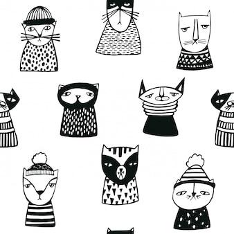 Modello senza cuciture con museruole di gatti divertenti cartoon. personaggi di gattino doodle disegnato a mano.