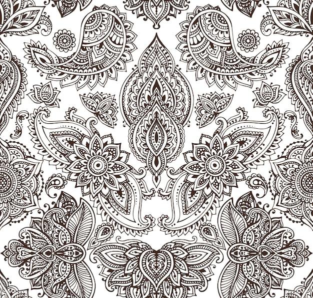 Seamless con elementi floreali mehndi hennè disegnati a mano.