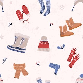 Modello senza cuciture con abbigliamento a maglia e stivali invernali su sfondo chiaro