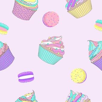Modello senza cuciture con macaron e cupcake Vettore Premium