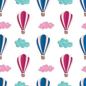 Modello senza cuciture con nuvole e mongolfiere rosa e blu. motivo per sfondi, tessuti, cartoline, cancelleria.