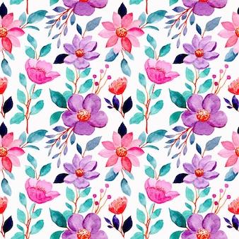 Modello senza saldatura con fiori viola rosa e foglie verdi acquerello