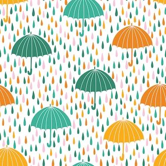 Modello senza saldatura con gocce di pioggia e ombrelloni. sfondo primavera