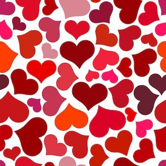 Modello senza cuciture con cuori rossi. cuori rossi vorticosi su sfondo bianco. illustrazione vettoriale di san valentino.