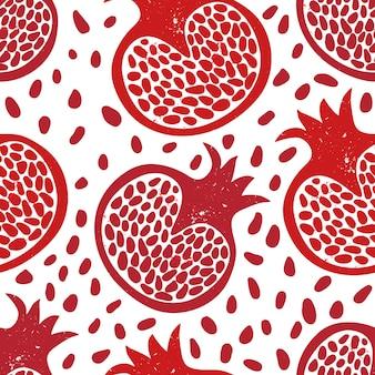 Modello senza cuciture con frutti e semi di melograno rosso