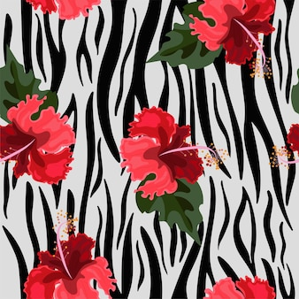 Modello senza cuciture con pelle di tigre e fiori di ibisco.