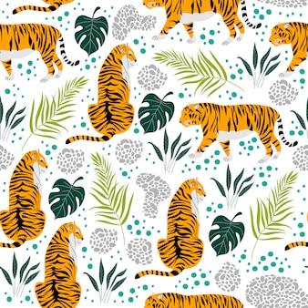 Modello senza cuciture con tigri e foglie tropicali