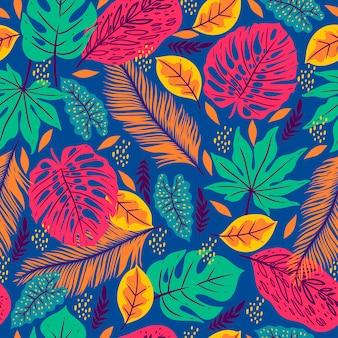 Modello senza cuciture con foglie tropicali su sfondo blu. grafica.