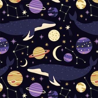 Modello senza cuciture con balene, pianeti e stelle su sfondo blu
