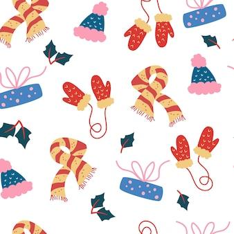 Modello senza cuciture con abbigliamento invernale. sciarpa, guanti e cappello. abbigliamento caldo e accogliente di stagione. sfondo di natale. carta da regalo. perfetto per tessuti, tessuti, carta da parati, carta, confezioni o cartoncini.