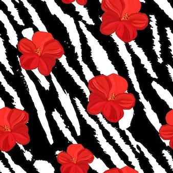 Motivo tigre senza soluzione di continuità e fiori motivo tigre che ripete lo sfondo