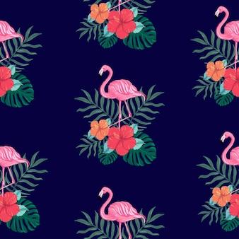Motivo estivo tropicale senza soluzione di continuità con fiori di ibisco e uccelli fenicotteri