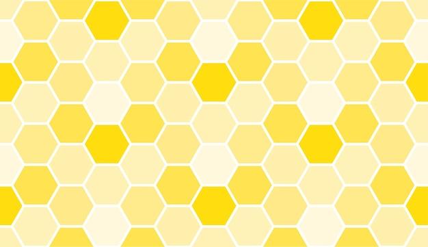 Modello a nido d'ape giallo senza soluzione di continuità, modello di sfondo artistico. trama di miele vettoriale