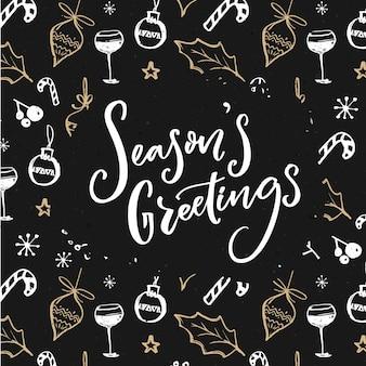 Testo di auguri di stagione sul modello di decorazioni natalizie. design scuro con scarabocchi bianchi e dorati.