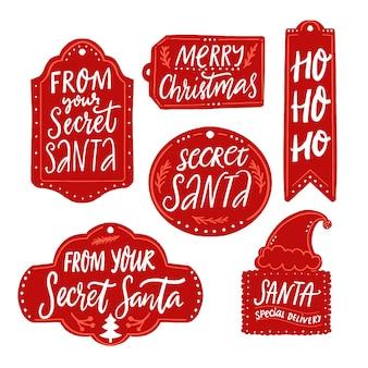 Tag regalo di babbo natale segreto etichette rosse iscrizioni merry christmas ho ho ho santa consegna speciale