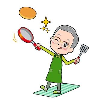Un uomo anziano con un gesto di cuoco pancake.
