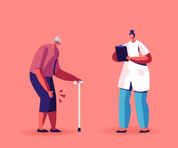 Senior donna con artrite reumatoide delle articolazioni del ginocchio in movimento con il bastone da passeggio in casa di cura o in ospedale