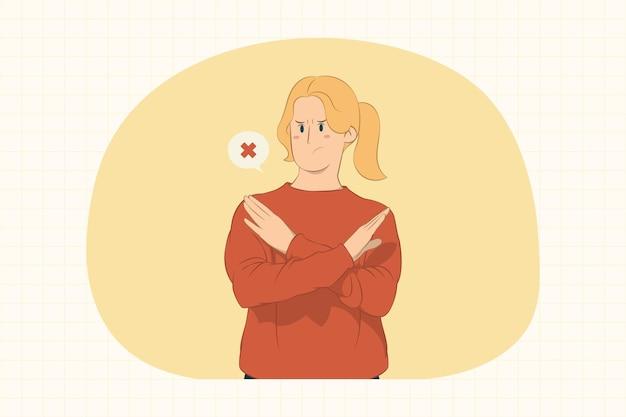 Grave giovane donna che mostra il gesto di arresto con il concetto di mani incrociate