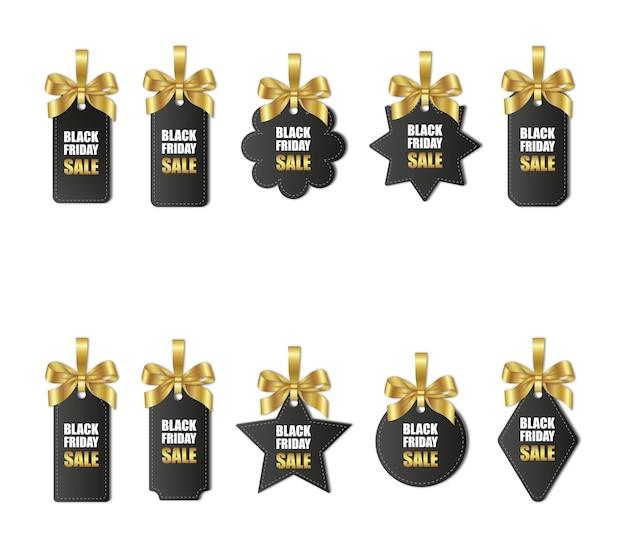 Set di cartellini dei prezzi del venerdì nero con fiocchi d'oro e nastro